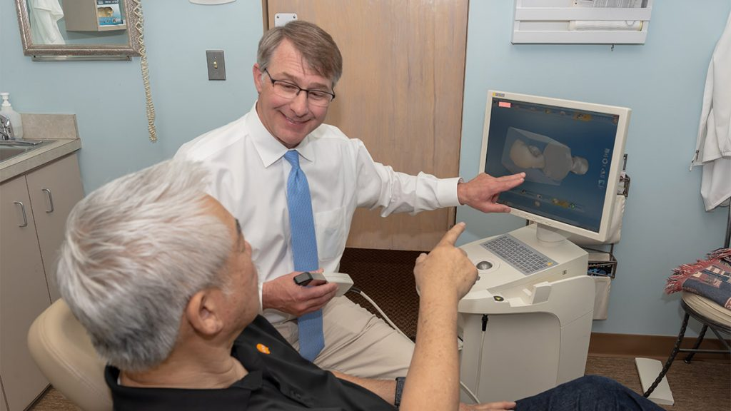 Dr. Fleming demonstrating CEREC 3D Scan