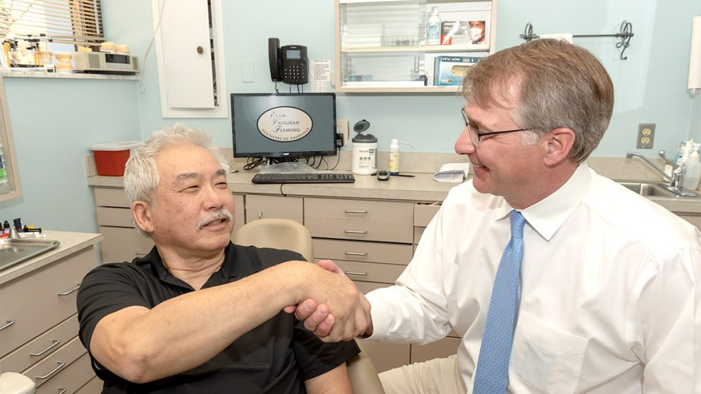 Dr. Fleming shaking hands with patient