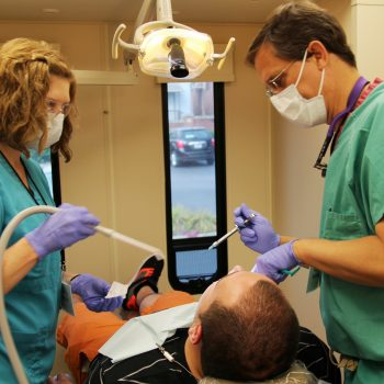 Dr. Vaughan and a team member working on a patient